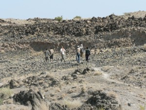Field team walking towards fresh fault rupture